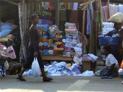 Ghanaian Woman in Front of Cloth